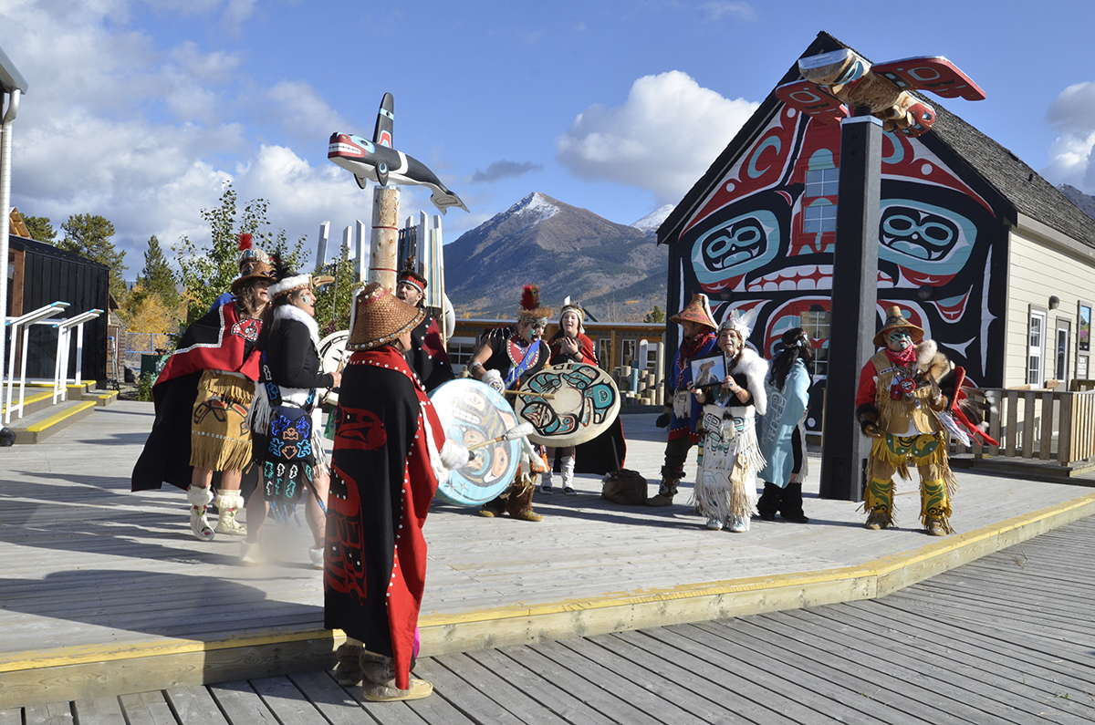The Dakhká Khwáan inland Tlingit dance group perform traditional songs and dances in the Carcross Commons. The Commons is both a tourism destination and a gathering place for the community. (Photo: Government of Yukon)