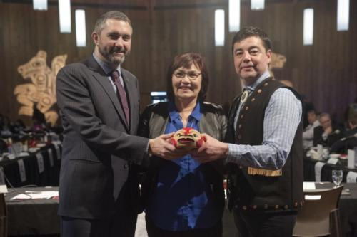 Yukon Premier Sandy Silver, Kwanlin Dün First Nation Chief Doris Bill, and Council of Yukon First Nations Grand Chief Peter Johnson hold a ceremonial Potlatch bowl that will be displayed at each Yukon Forum. It symbolizes the new relationships and new beginnings between the the Yukon and First Nations governments. (Photo: Government of Yukon)